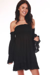 Front shows black mini dress length featuring a smocked top with off the shoulder bell sleeves tub top style top, and crochet lace detailing at hemlines.
