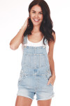 Front shows Light blue denim overall shorts with pockets. Shown paired with white short sleeve tank.