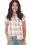 Front shows short sleeve blouse featuring a button up front with left breast pocket, super soft white and brown plaid material, stripe up sides. Shown paired with light blue jeans.