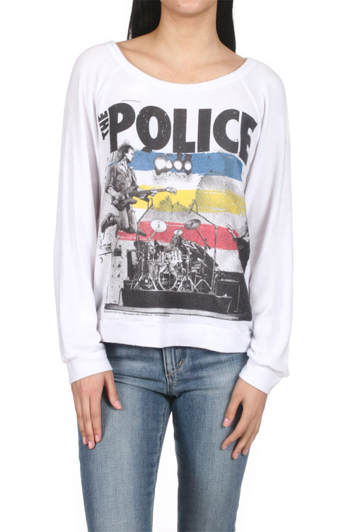 """Brenna The Police  Band Pullover Sweater White l/s pullover sweater with band logo of """"The Police"""" Shows a stage, drummer and guitarist jumping while playing. for more detail contact toll free 855-597-0313"""