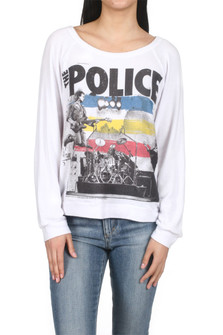 "Brenna The Police  Band Pullover Sweater White l/s pullover sweater with band logo of ""The Police"" Shows a stage, drummer and guitarist jumping while playing. for more detail contact toll free 855-597-0313"