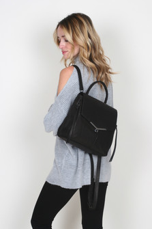 Valentina Leather Backpack in black can be worn with one strap over shoulder or two backpack straps For more details contact toll free 855-597-0313