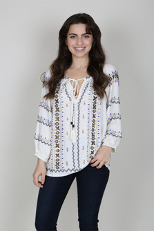"""Phoenix"" blouse w/ beads all over in aztec like print Round neckline; tasseled self-tie keyhole Three-quarter sleeves. High-low hem. for more details call toll free 855-597-0313"
