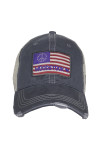 Front shows charcoal trucker hat features a distressed curved brim, mesh sides, adjustable plastic snap back, and Woodstock  American flag logo at the front.