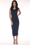front shows all over light navy color with scoop front neckline and ruching at sides. midi length in middle of calves. Shown worn with tan open toes heels.