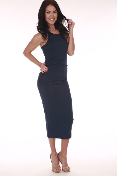 front shows all over light navy color with scoop front neckline and ruching at sides. midi length in middle of calves