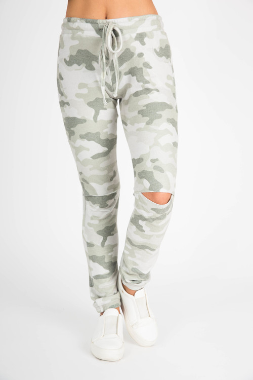 front shows elastic waistband with drawstring, knee slits at both knees and cuffed ankles in light camo green color.