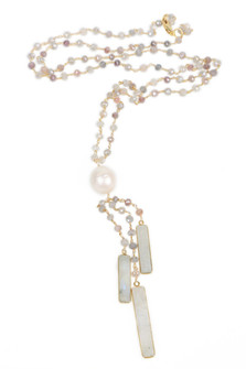 Pearl Tassel Necklace Beaded pearl Necklace Large pearl before tassel which is beaded with three large rectangular pearls Pearl & Gold For more detail contact toll free 855-597-0313