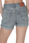 Back shows light blue cuffed denim shorts with distressed style and two  pockets.