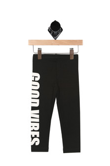"""Good Vibes Leggings in black feature """"GOOD VIBES"""" down side of right leg in bold white lettering elastic waistband at top"""