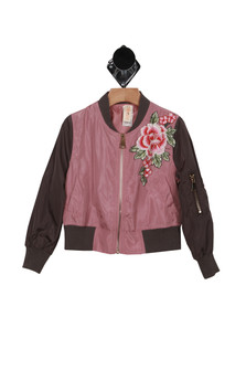 Bomber Jacket W/ Flower Applique  dark purple sleeves with darker pink body pink flower applique at left breast zipper front closure with side pockets zip pocket on left arm