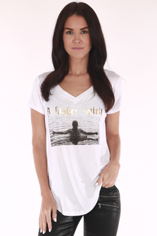 "A Higher Spirit Tee in white v-neck looser fit with short sleeves features ""A higher spirit"" in gold foil with girl in water graphic"