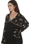 side of Diamond Embroidered L/S Tunic Blouse in black with ivory embroidery detailing v-neckline, looser fit