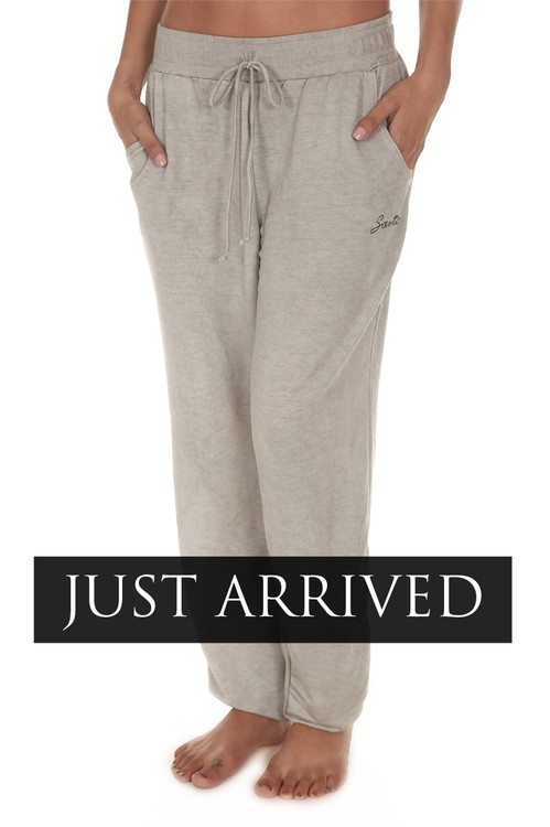 "Embroidered Santo Jogger Pants in Light Grey elastic wiastband with drawstring embroidered ""Santo"" logo at upper left thigh"