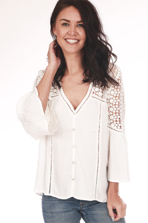 Front shows off white long sleeve crochet blouse with crochet design on shoulders  and  v shape neck line.