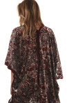 Back view  of Velvet Floral Burnout Kimono with Black Fringe detailing at bottom hemline oversized fit velvet floral print is mainly maroon with pink, cream and green flowers for details call toll free 855-597-0313