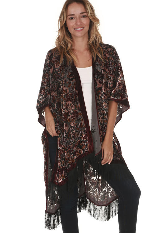Velvet Floral Burnout Kimono with Black Fringe detailing at bottom hemline oversized fit velvet floral print is mainly maroon with pink, cream and green flowers for details call toll free 855-597-0313
