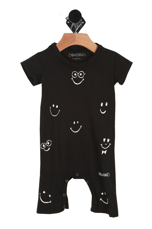 front of onesie has scoop neckline, short sleeves and white smiley face graphics all over