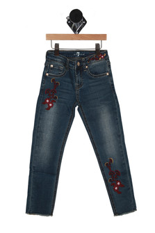 Front of embroidered raw edge skinny jeans in medium to dark denim with pink and yellow embroidered flowers & button/zipper front closure