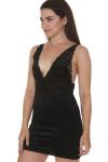 side of Viper Velvet bodycon mini dress in black low v-neckline front short hemline