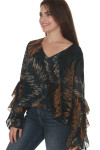 side of Midnight palm long sleeve blouse  print is black background with blue, white and orange palm leaves all over worn with denim jeans