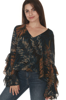front of Midnight palm long sleeve blouse  print is black background with blue, white and orange palm leaves all over worn with denim jeans