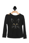 front of sweater has cut out at top right shoulder. long sleeves. black sweater with cat face graphic at front.