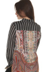 back of English Rose Button Up Blouse  main blouse print is black and white vertical striping with contrasting paisley-like material at entire back
