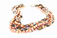 6 Strands pearls. brown shell, coin clasp