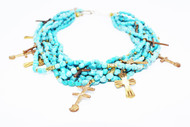 7 strand small turquoise nuggets, gold plated crosses