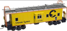 Atlas O Chessie system (yellow)  Bay window caboose,  3 rail