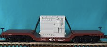 "MTH Railking  ""MTH Construction"" Depressed center flat car with transformer, 3 rail"