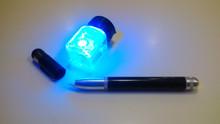IF-PAP ink under 385nm illumination, plus ambient lighting.