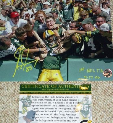 RARE!  Greg Jennings 85  Rookie Year signed  1st NFL T.D. 9-17-06 inscribed  8x10 Color Lambeau Leap photo  with Legends of the Field COA & Greg's   exclusive GJ85 Hologram Authentication.