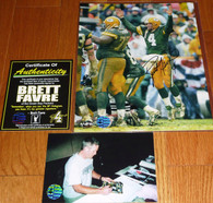 Official Brett Favre LOGO     BRETT FAVRE hand-signed      Touchdown celebration vs the San Francisco 49ers 8x10 photo     with Official Brett Favre Authentication.  Triple Matching Holograms with Official Brett Favre COA, signing photo with toploader