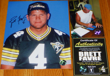 BRETT FAVRE hand-signed  4 inscribed  1994 Press   8x10 photo   with Official Brett Favre Authentication.  Triple Matching Holograms with Official Brett Favre COA, signing photo with toploader