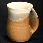 Handwarmer Mug in Desert Sand. Available with right-handed or left-handed handles. Please call (970) 586-2151 to purchase.
