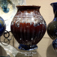 "This Sunflower Vase is handmade by Bill Campbell based in Cambridge Springs, PA. The vase is approximately 8"" and is shown in New Glaze, dark option.  Each porcelain form is hand glazed and the crystals can vary greatly in the Stellar glaze. Please call to confirm we have a similarly pictured piece on-hand."