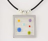 """Large Square Pendant with Dots"" by Ann Carol Jewelry from Boundbrook, NJ. Each piece is made with sterling silver and accented with hand painted enamel designs with waxed cotton cord."