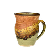 This Large Round Mug in Safari glaze is handmade by Sunset Canyon Pottery. Due to the handmade nature of the pottery, expect slight differences from item to item with respect to size, shape, and glaze, even within sets of items.