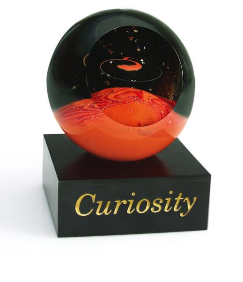"""Curiosity"" glass paperweight handmade by Glass Eye Studio."