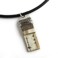 "N21S Classic Hematite Necklace from Tessoro Jewelry, natural birchbark, hematite and sterling silver wrap, black leather cord 17"", 1 1/4"" x 3/8"" pendant."