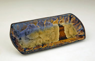 "This Butter Tray is handmade by Bill Campbell based in Cambridge Springs, PA. It is 7 1/4"" and is shown in his gold glaze. We offer Bill Campbell's two different Flambeaux glazes Cream/Green/Blue and Gold glaze. All of his porcelain is functional; microwave, oven, & dishwasher safe."