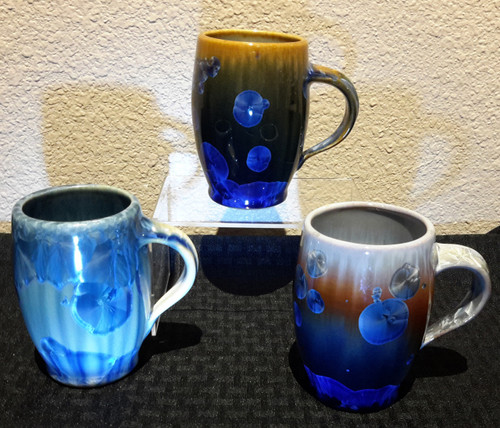 "This Bistro Mug is handmade by Bill Campbell. The mug is 4 1/2"" x 5"" wide and holds 11oz. It is available in Cream/Green/Blue or New Glaze, dark and Light Stellar glaze. All of his porcelain is functional: microwave, oven, and dishwasher safe. Each porcelain form is hand glazed and crystals grow in the firing process so colors and patterns will vary. Please call for current photos of on-hand pieces. (970) 586-2151."