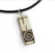 "NON2 Nordic Swirl Necklace by Tessoro Jewelry, natural birchbark, hand hammered sterling silver, black leather cord 17"", pendant 1 1/2"" x 3/8""."