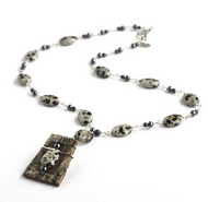"""SHOWJ Sienna Dalmatian Jasper Necklace by Tessoro Jewelry, natural birchbark pendant, recycled copper,hand hammered sterling silver, dalmation jasper and hematite linked with sterling silver, sterling silver toggle clasp 18"""", pendant is 1 3/4"""" x 1""""."""