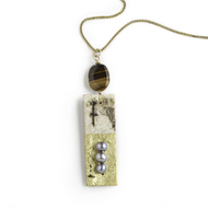 "EN11 Rectangular Gold Leaf Necklace by Tessoro Jewelry, 23k gold leaf on natural birchbark, tiger eye and freshwater pearls, vermeil box chain 18"", pendant is 2"" x 1/2""."