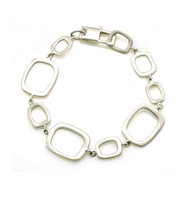 "Multi Open Square Silver Bracelet by Philippa Roberts Jewelry based in Oakland, CA. Brushed sterling silver squares with lobster clasp and 7"" in length."