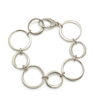 "Multi Open Circle Silver Bracelet by Philippa Roberts Jewelry based in Oakland, CA. Brushed sterling silver circles with lobster clasp and 7 3/8"" in length."
