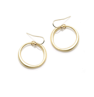"Large Circle Vermeil Earrings by Philippa Roberts Jewelry based in Oakland, CA. Large organic circle in brushed gold vermeil on gold french wires hanging 1 1/4""."